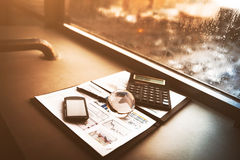 Business financial analysis the workplace with a globe and phone calculator. Business financial analysis of the workplace with a globe and phone calculator Royalty Free Stock Photography