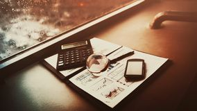 Business financial analysis the workplace with a globe and phone calculator. Business financial analysis of the workplace with a globe and phone calculator Stock Images
