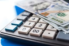 Business and financial background with dollars and calculator. Bookkeeping background. stock photo