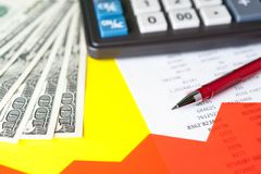 Business and financial background with dollars, data, pen and calculator. Bookkeeping background. stock image
