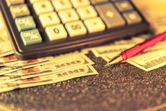 Business and financial background with dollars, pen and calculator. Bookkeeping background. royalty free stock images