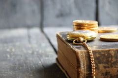 Business or financial background with pocket watch, book and coins Royalty Free Stock Images