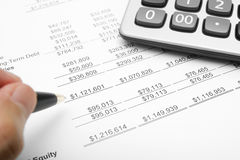 business financial chart analysis with calculator, pen & hand Stock Image