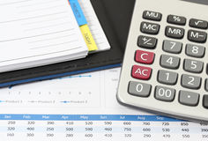 Business and financial. Closeup image of calculator and book on business report for working Stock Images