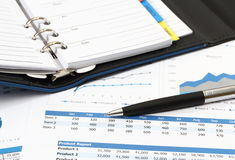 Business and financial. Closeup image of pen and book on business report for working Stock Photos