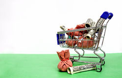 Business Financial Concept - Shopping Cart with Money Royalty Free Stock Photos
