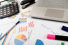 Business financial data analyst workplace. Desk with graph and chart documents stock photos