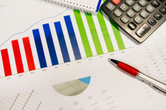 Business and financial graph. Business and financial growth graph with pen, calculator and notebook royalty free stock image