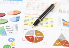 Business and financial. Image of graphics and finance report for business with pen Stock Images