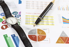 Business and financial. Image of graphics and finance report for business with pen and watch Royalty Free Stock Photography