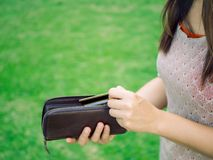 Business and financial, money saving concept. Closeup woman hand putting credit card into leather wallet . Business and financial, money saving concept Stock Photo
