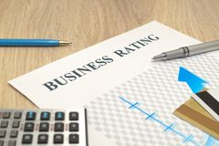 Business financial rating chart with pen, bank cards and calculator. royalty free stock photography