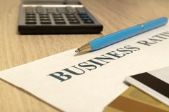 Business financial rating chart with pen, bank cards and calculator royalty free stock image