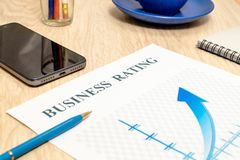 Business financial rating chart with pen, bank cards and calculator stock photos