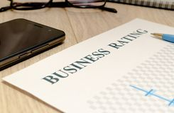 Business financial rating chart with pen, bank cards and calculator royalty free stock photos