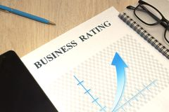 Business financial rating chart with pen, bank cards and calculator royalty free stock photography