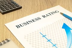 Business financial rating chart with pen and calculator. On desk royalty free stock photo