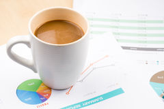 Business and financial report with coffee.Graph,book,glasses,Document is mockup Stock Photos
