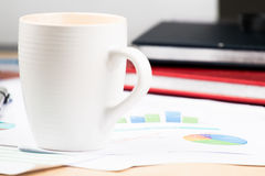 Business and financial report with coffee.Graph,book,glasses,Document is mockup Stock Image