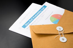 Business and financial report  in envelope.pen,document is mock up. Royalty Free Stock Image