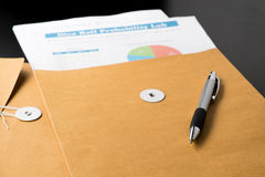 Business and financial report  in envelope.pen,document is mock up Stock Photo