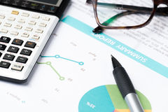 Business and financial report with pen and calculator on wooden Royalty Free Stock Photos