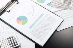Business and financial report with pen and calculator on wooden Royalty Free Stock Photography