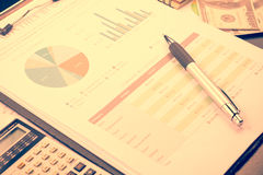 Business and financial report with pen and calculator on wooden Stock Photography