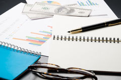 Business and financial report with pen and calculator on wooden Royalty Free Stock Images