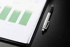 business and financial report with pen.Document is mockup. Stock Images