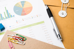 business and financial report with pen.Document is mockup. Royalty Free Stock Image