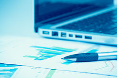 Business and financial report with pen. Document is mockup Stock Images
