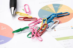 Business and financial report with pen.paper clip. Royalty Free Stock Photos