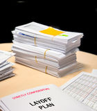 Business financial statement with envelops on planning table Royalty Free Stock Image