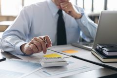 Business Financing Accounting Banking Concept, businessman doing. Finances and calculate about cost to real estate investment and in other, tax system Stock Image