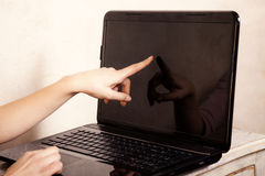 Business. Finger touching screen computer laptop Royalty Free Stock Image