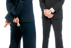 Business fingers crossed front boss isolated. Business concept fingers crossed in front of boss isolated on white background stock images