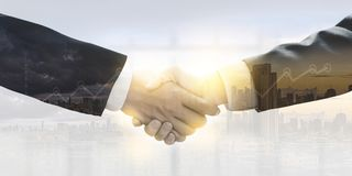 Business finishing up a meeting Partners shaking hands businessman Teamwork royalty free stock photo