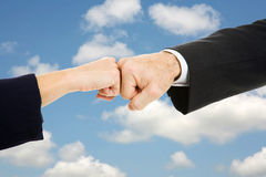 Business Fist Bump Sky Stock Photos