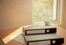 Business folder files and coffee on desk by windows. Business folder files and coffee on desk by the windows Royalty Free Stock Photography