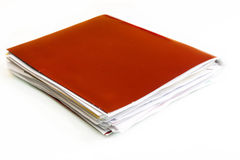Business Folder on a White Background. Folder full of business papers: bills, accounts receivable,invoices,receipts,etc. Blue folder with a business paperwork Stock Photos