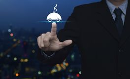 Business food delivery online concept. Businessman pressing restaurant cloche flat icon over blur colorful night light of city tower and skyscraper, Business royalty free stock photos