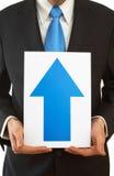 Business forecast. Business concept with businessman holding upside blue arrow Stock Photos