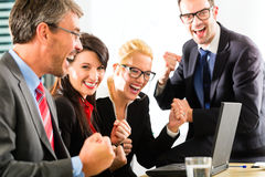 Business people looking at laptop with success Royalty Free Stock Photography