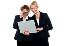 Business friends enjoying video on laptop Stock Images