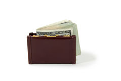 Business funds. Burgandy leather suitcase used to carry items to the office, Money in the form of many large bills Stock Images