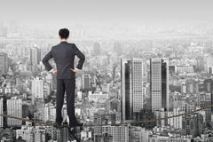 Business future. Chinese business man stand on rope. Photo manipulation  about risk, adventure, future or dream etc Stock Images