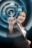 Business and future technology concept - smiling businesswoman w. Orking with virtual screen Royalty Free Stock Photography