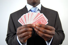 The Business Gamble. This is an image of a business man holding a set of cards. This is a metaphor for business gamble stock images