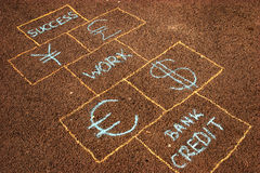 Business is a game. Business hopscotch made on sidewalk Royalty Free Stock Image